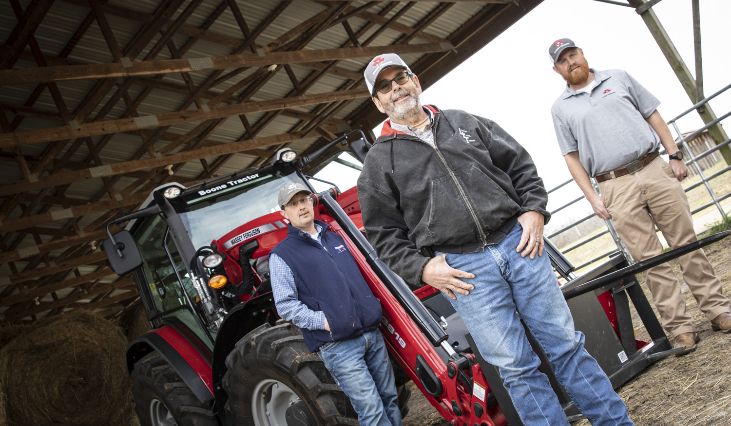 William White, store manager with the Danville, Virginia, location of Boone Tractor, and AGCO Field Specialist Mark Frutchey  visit with Michael.
