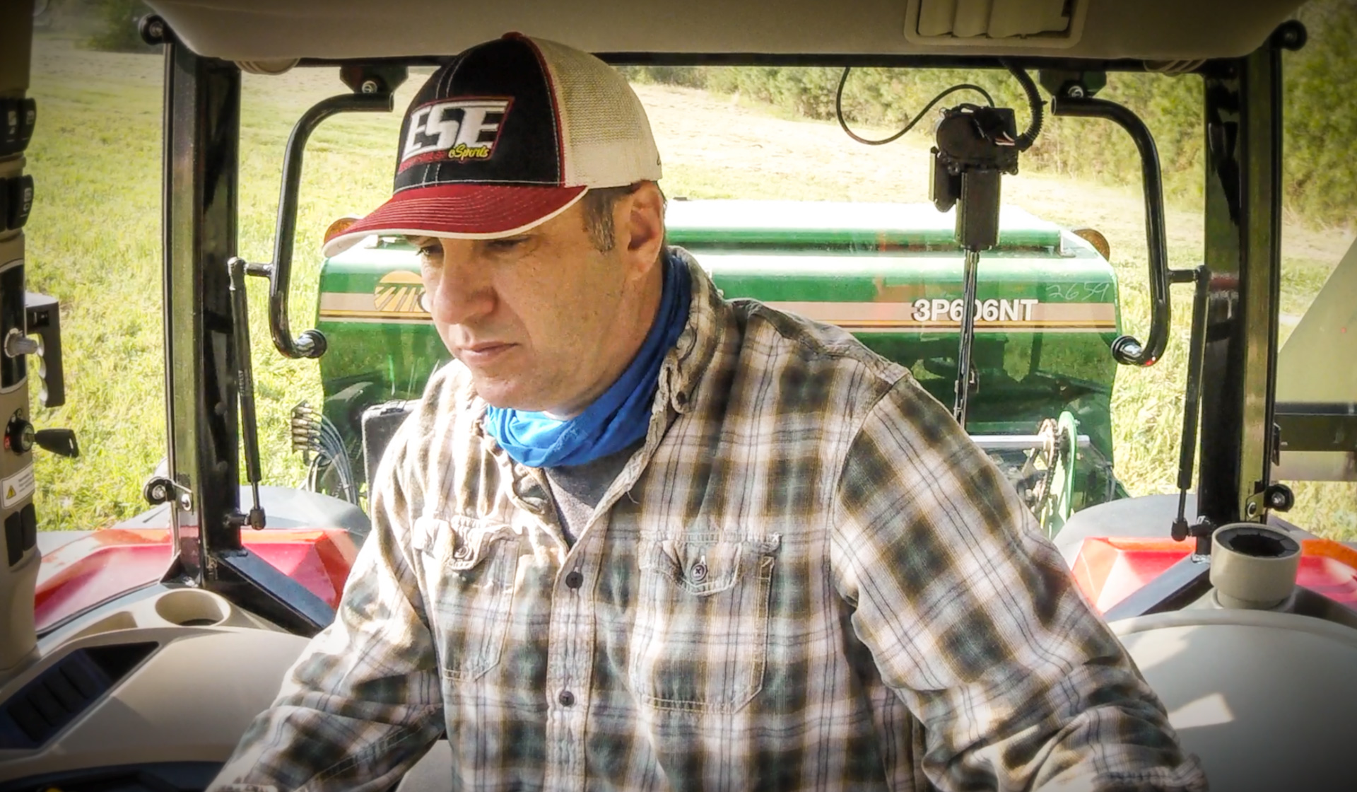 In the cab of the MF4707 with Sadler.