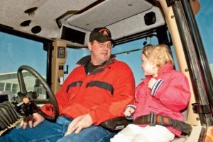 Craig's AGCO DT180A not only offers high-tech features, but also has a seat for daughter Amber or any one of his three children.