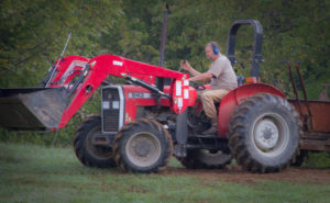 Robertson's 243 is the perfect tractor for his hilly property.