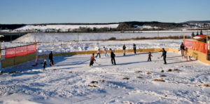 "While the rink David Brown built on his farm is, he says, ""a miniature model,"" family, friends and neighbors have all enjoyed it in a big way."