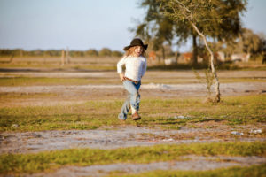 Cary thinks his spirited 5-year-old granddaughter Hattie Mae will one day take over the farm.