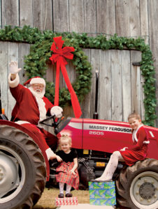 Donald Tharp as the right jolly old elf, on his new MF2605.