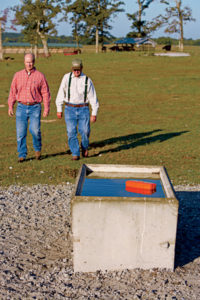 Hugh and Boyd Smith (above) added a dozen concrete watering troughs around the farm, along with surrounding heavy-use areas, with help from NRCS.