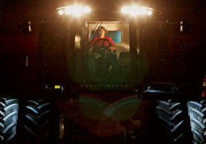 The Stuckes worked with and provided feedback on AGCO Auto-Guide, which helps farmers run equipment efficiently, not to mention well past dark. Here, Dave's son, Alex, operates the family's Gleaner Super Seven.