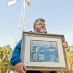 Jake Utsey holds dear his land and his family's history on it. Here, he displays a photo of life as it was on what is now a 30,000-acre operation in southeastern Alabama.