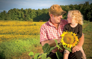 Rodney Fraser and daughter Rachel, photographed in one of the family's sunflower fields.