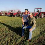 Terry and his grandaughter, Isabella Rose Button, check on an early morning baling operation.