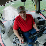 Brian Ussary drives one of his late model Massey Ferguson tractors on his farm in Missouri.