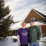 Sue and Bill Holbrook at their home on Marble River Farm, an alpaca farm.