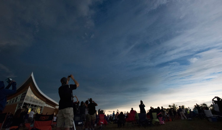 Crowds at the Homestead National Monument of America in Nebraska watch as the solar eclipse of 2017 entered totality.