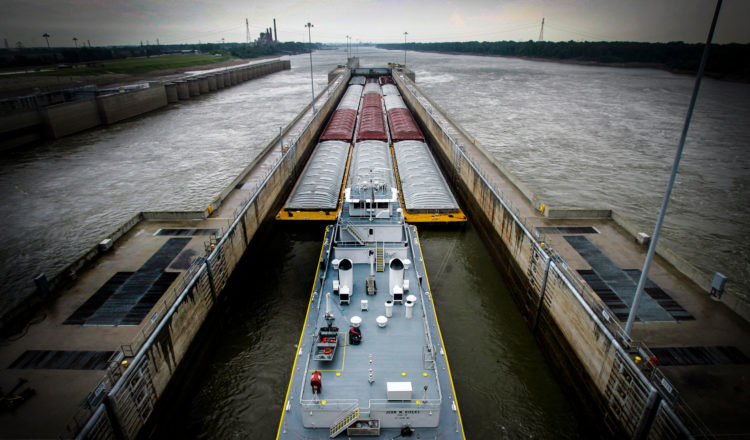 A view of the barges passing through the Melvin Price Locks on a dreary day.