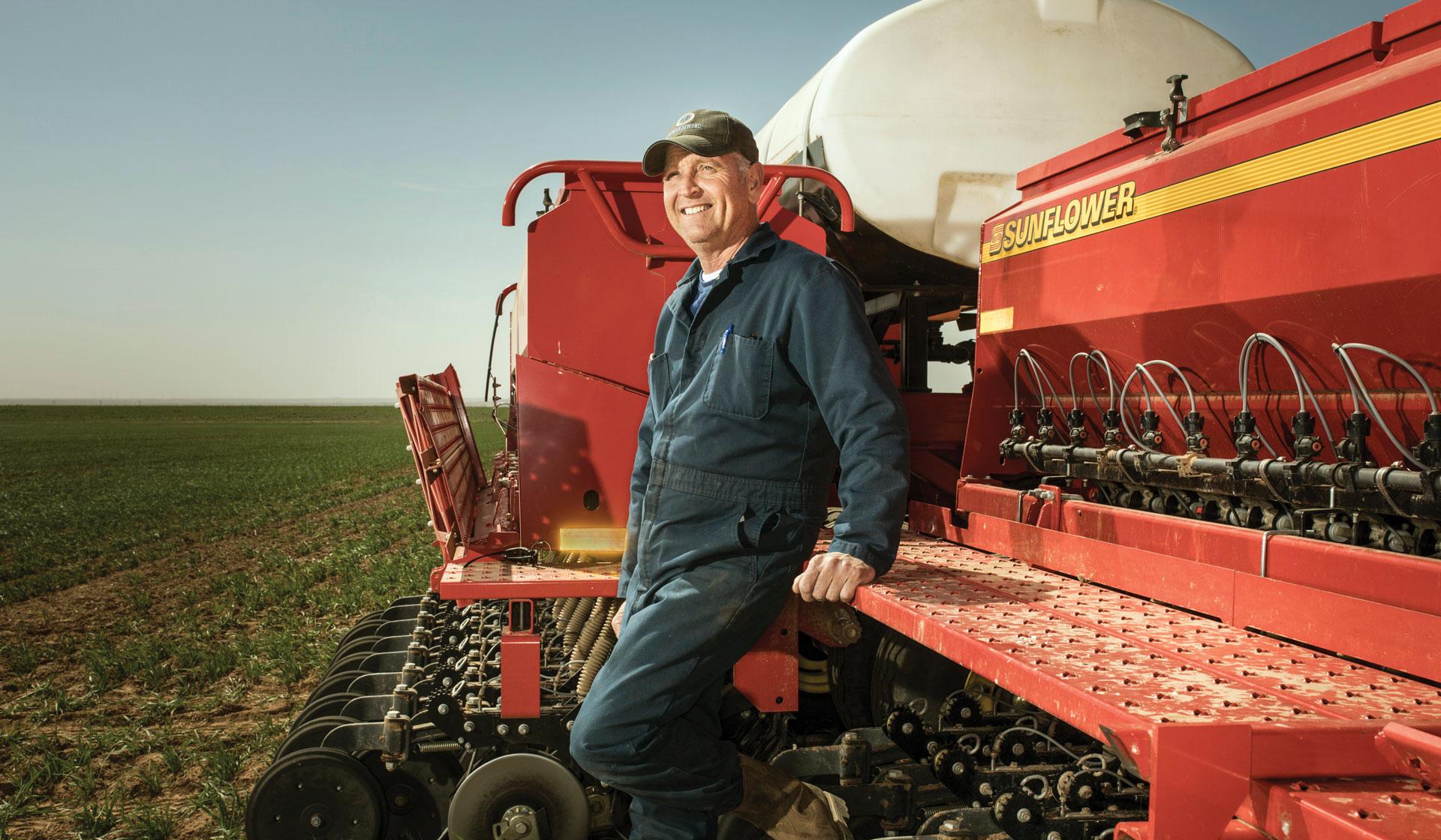 Pieter Vanderlaan stands in front of his Sunflower 9435 grain drill.