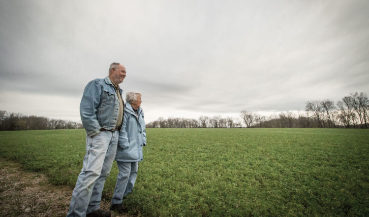 Lee Gilmore and his Mother look out over their fields.