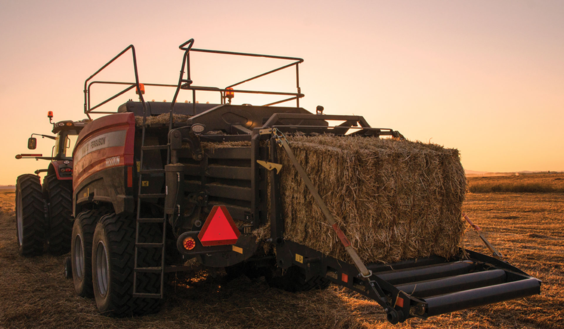 A Massey Ferguson baler in action.