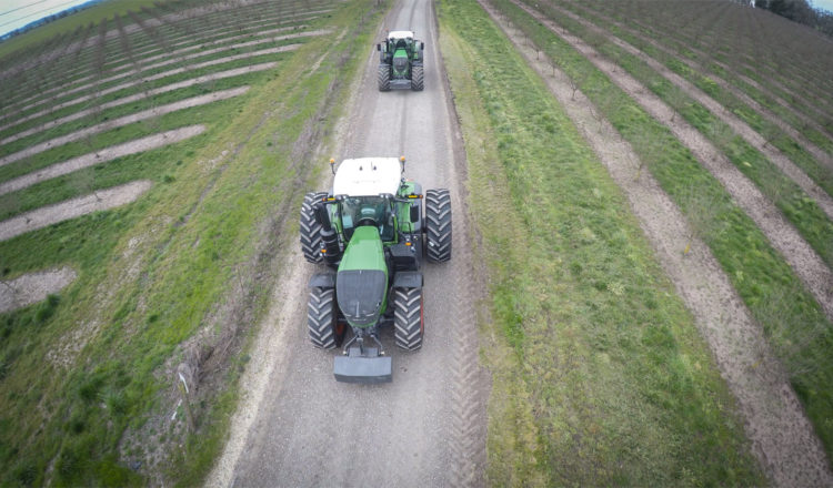 Two Tractors rumble down the path on Jered Rediger's farm.