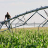 Rex Reyher stands by a center-pivot irrigation system on his farm.
