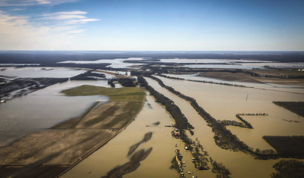 Backwater flooding covers stretches of farm lands near Yazoo City, Miss., Sunday, March 17, 2019, as seen in this aerial photograph. Various communities in the Mississippi Delta are combatting both Mississippi River flooding and backwater flooding that are affecting homes, businesses and farm lands. (AP Photo/Holbrook Mohr)